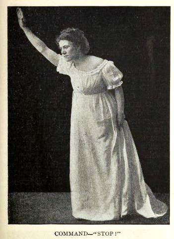 woman posing to command 'stop'